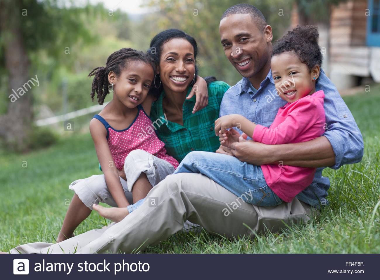 portrait of african american family of four - Stock Image