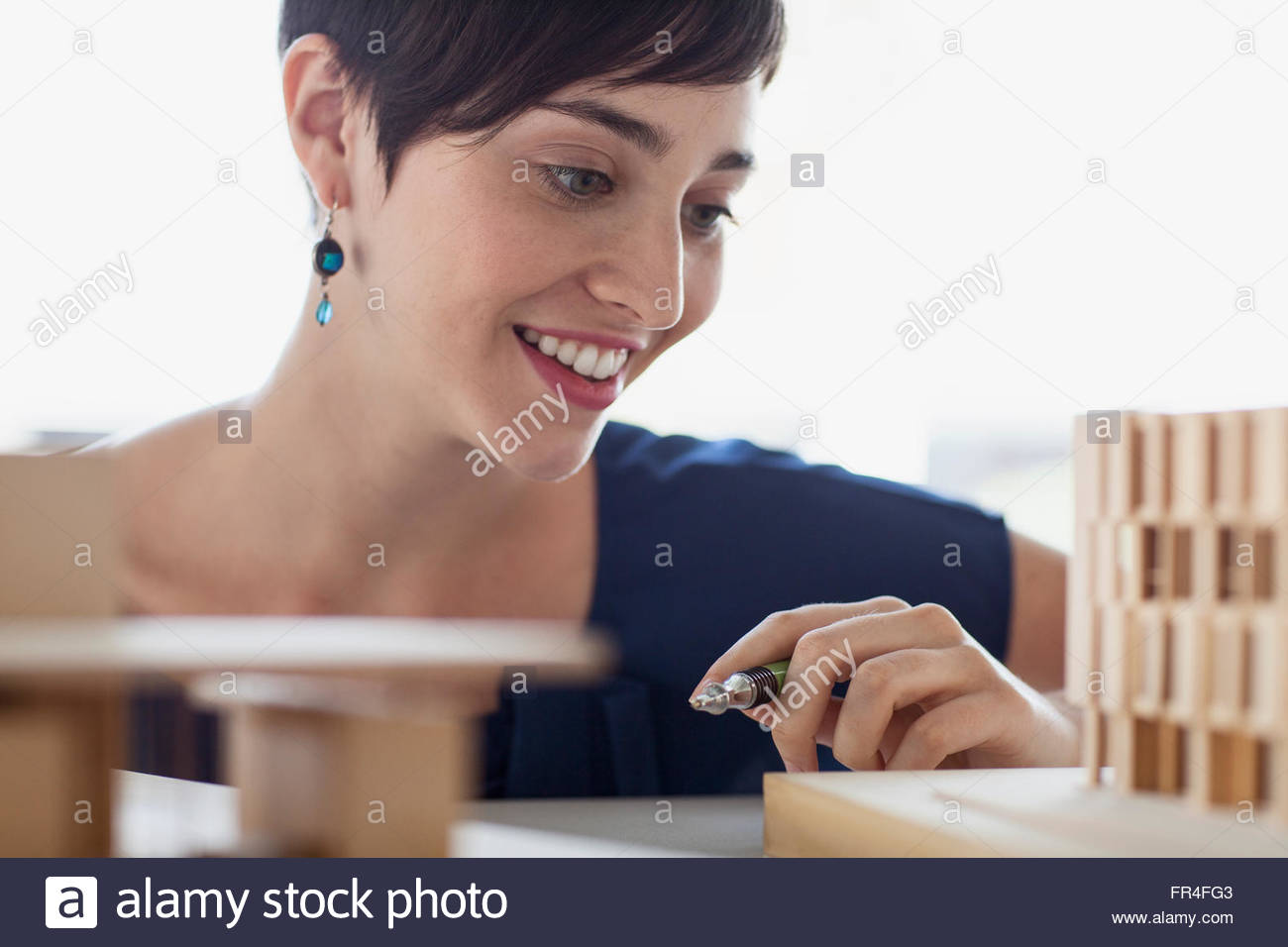 close up of female architect with model - Stock Image