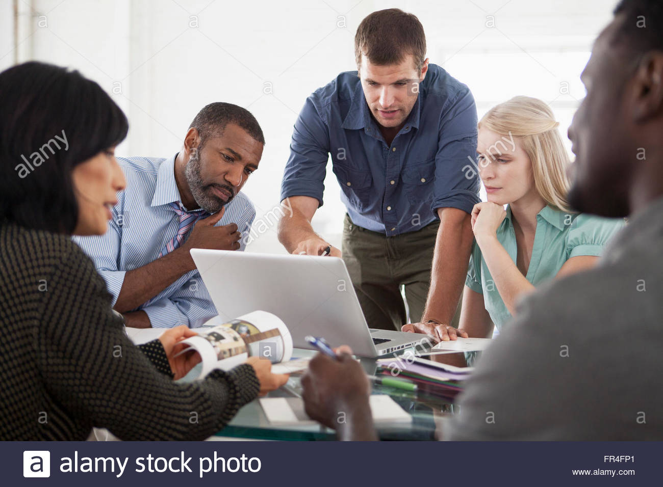 small group looking very concerned in business meeting - Stock Image