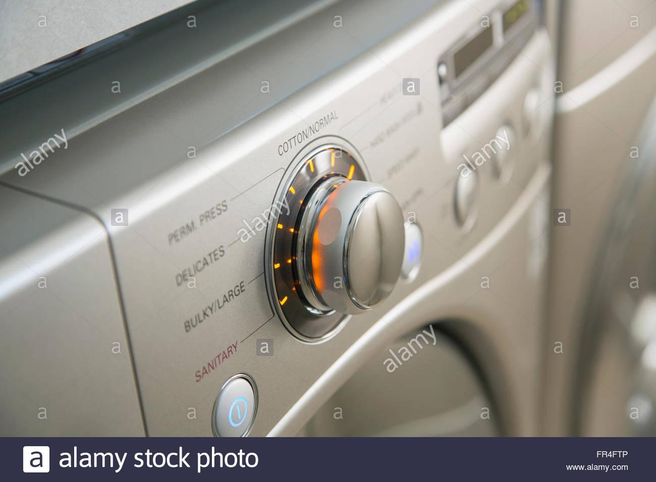 Close-up of settings on energy efficient washing machine. - Stock Image