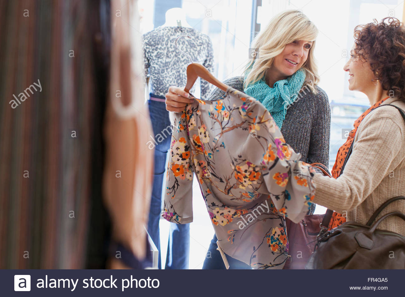 Friend asking for second opinion on clothing choice. Stock Photo