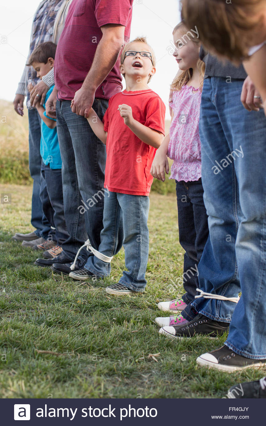 Parents and kids lined up for 3 legged race. - Stock Image
