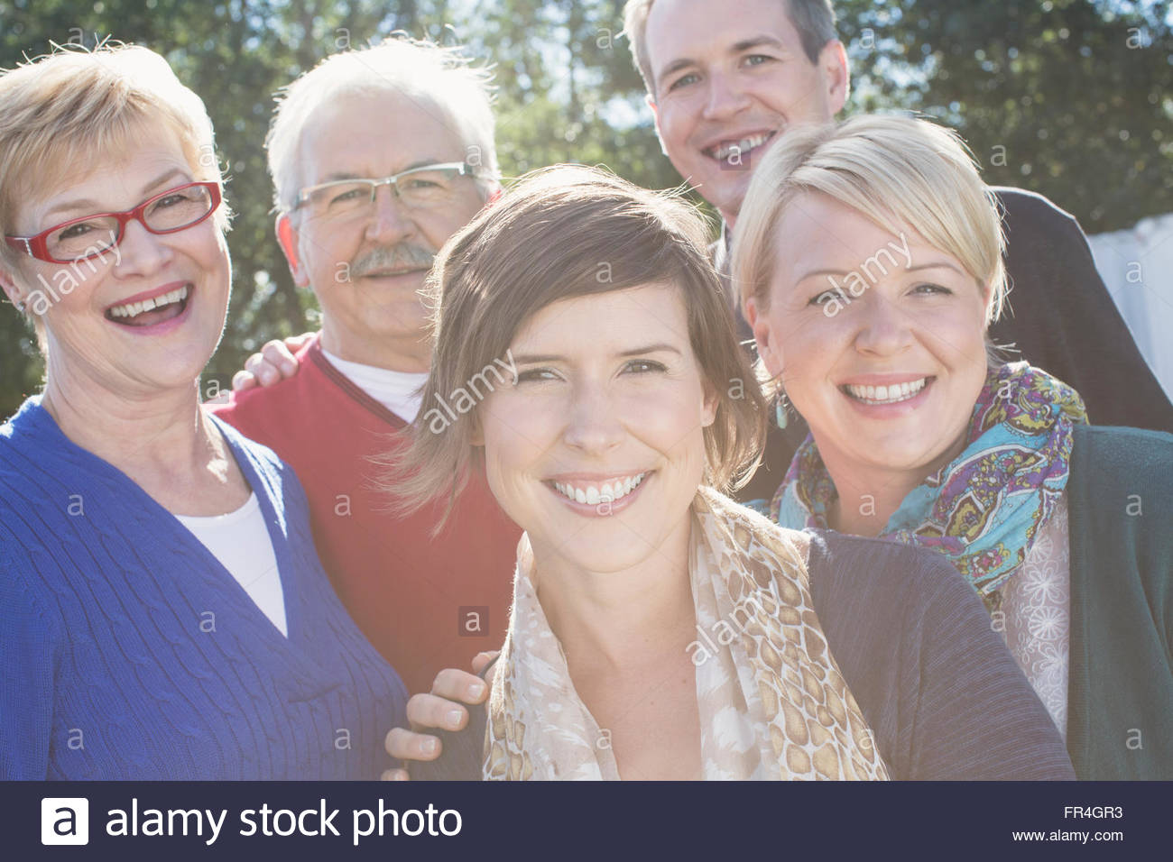 Portrait of parents with their three adult children. - Stock Image