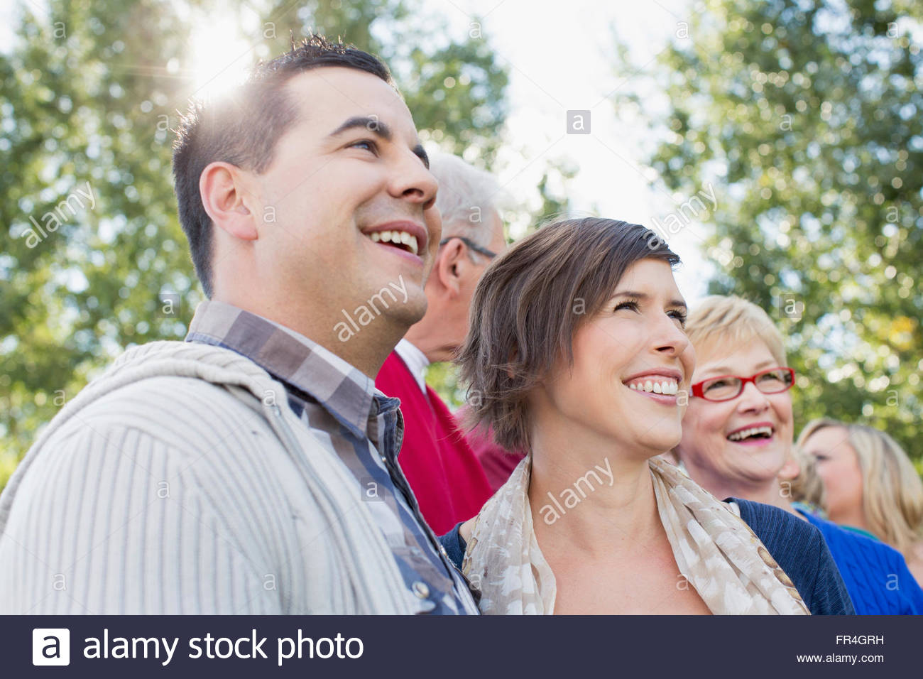 Husband and wife with parents and other family. - Stock Image