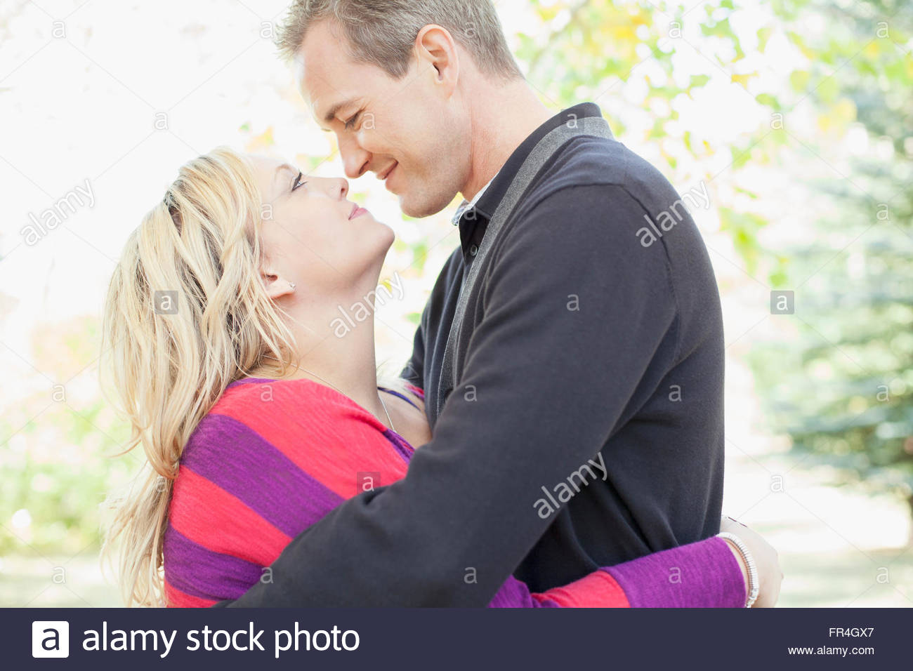 Husband and wife gazing into each others eyes. - Stock Image
