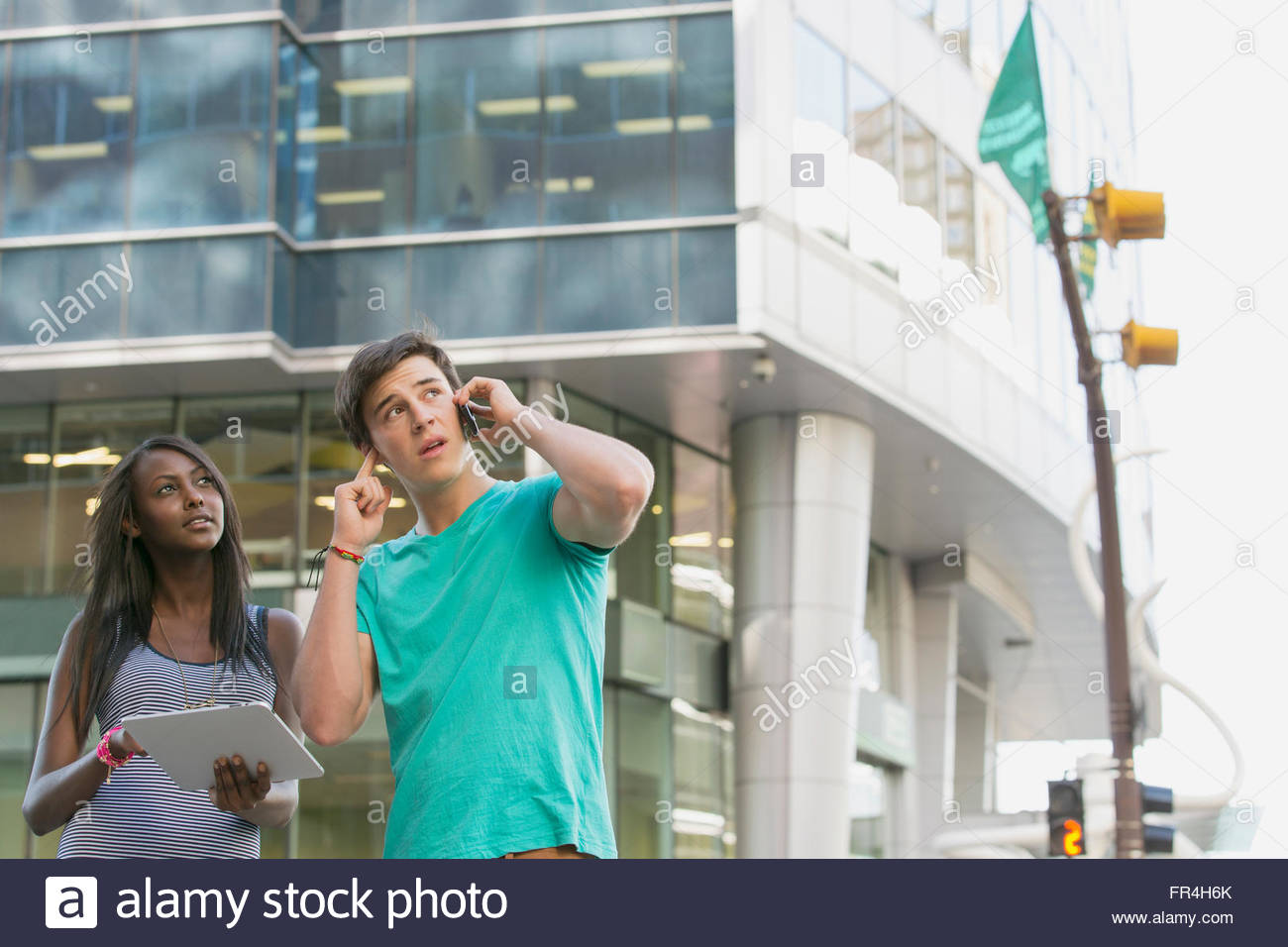teenagers using technology to find their way - Stock Image