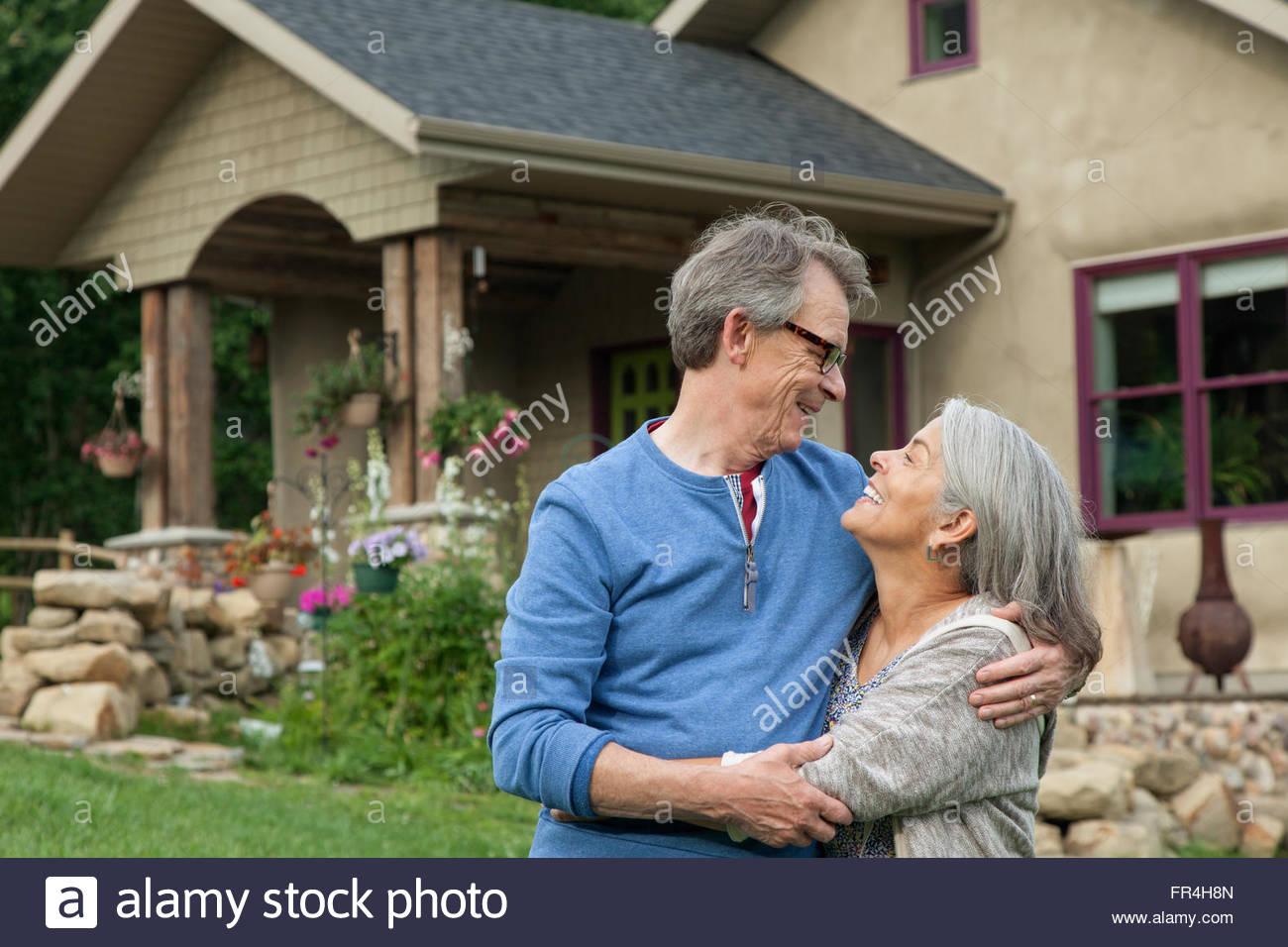 senior couple gazing into each others eyes - Stock Image