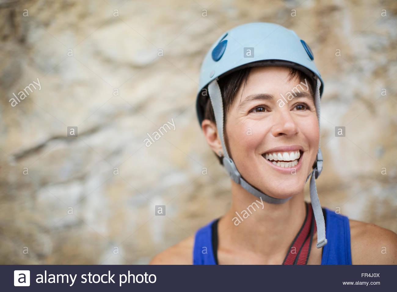 pretty, female rock climber wearing helmut - Stock Image
