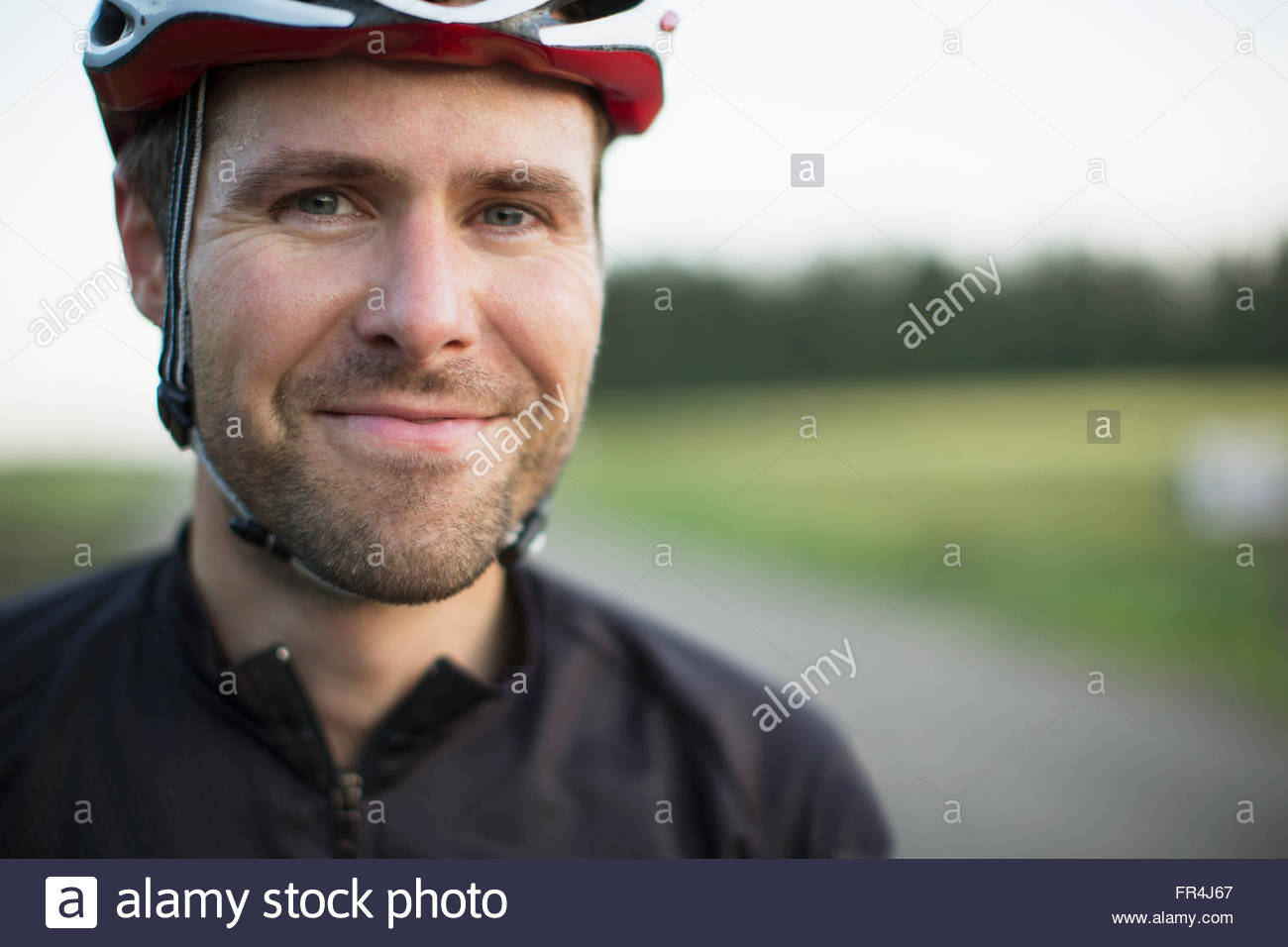 portrait of mid-adult male street bicyclist - Stock Image