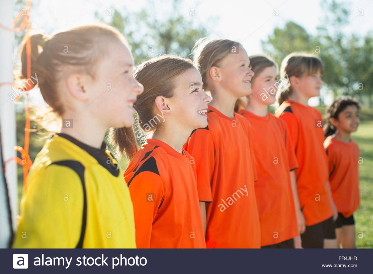 young female soccer players lined up - Stock Image