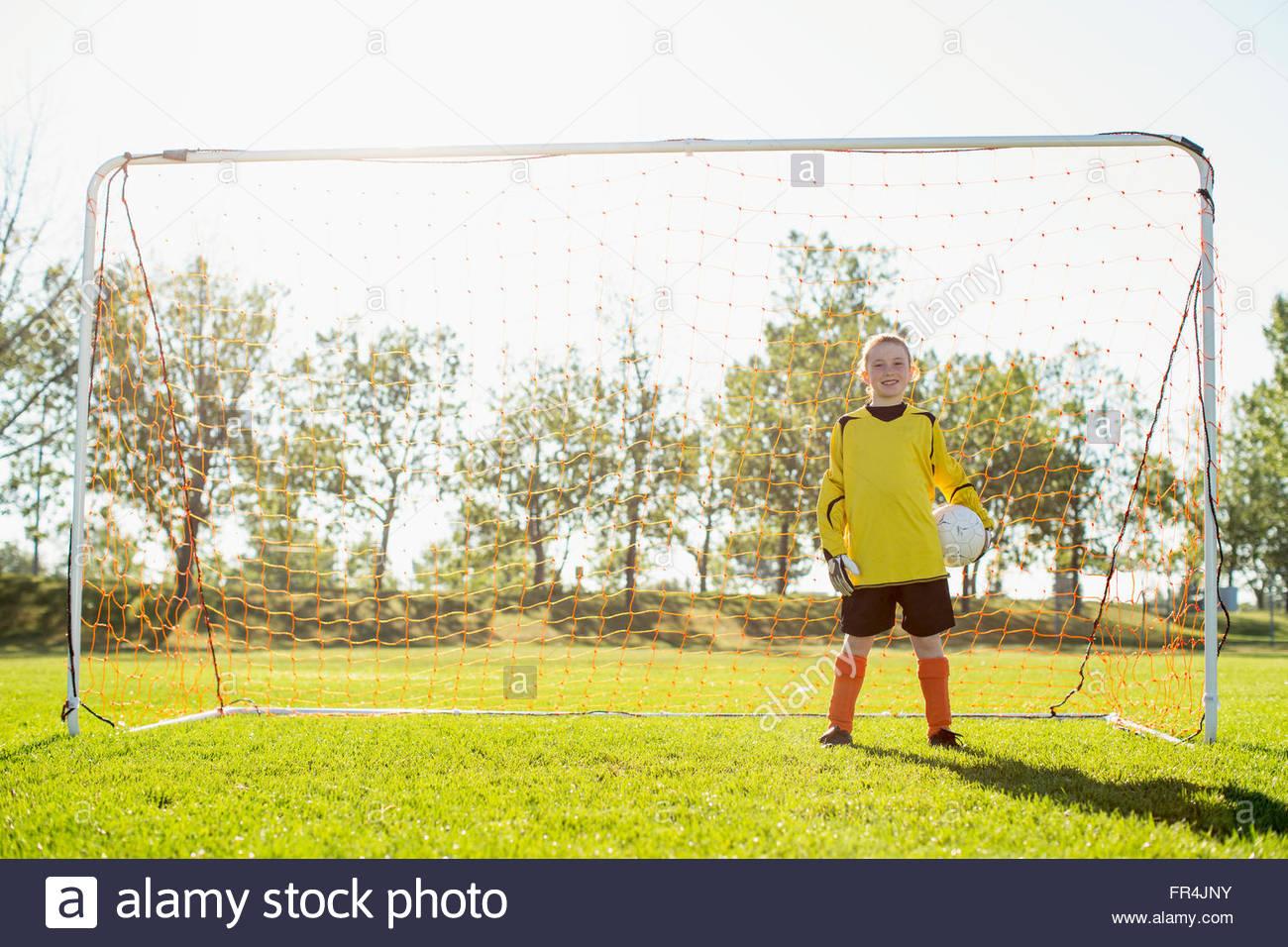 young female goalkeeper on girls soccer team - Stock Image