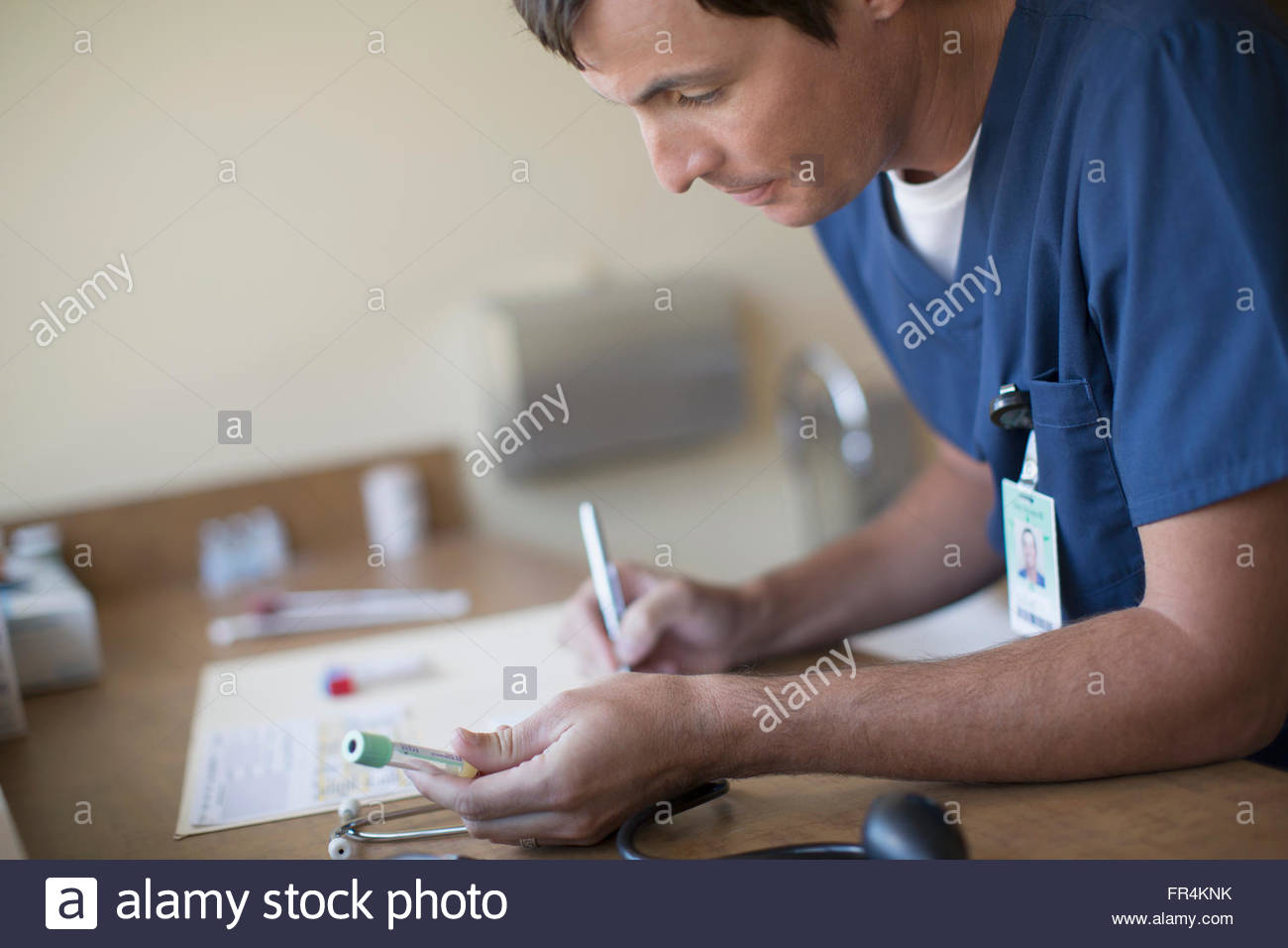 medical technician with vial for medical test - Stock Image