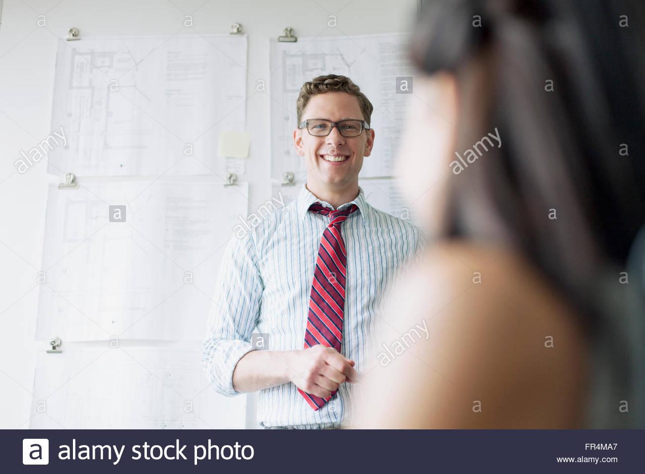 architect smiling during presentation - Stock Image