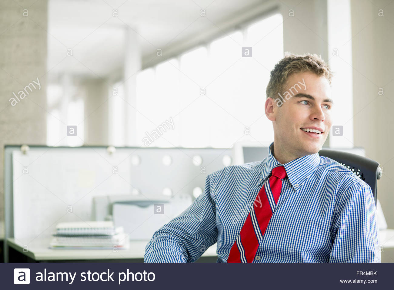 handsome, young adult businessman at office - Stock Image