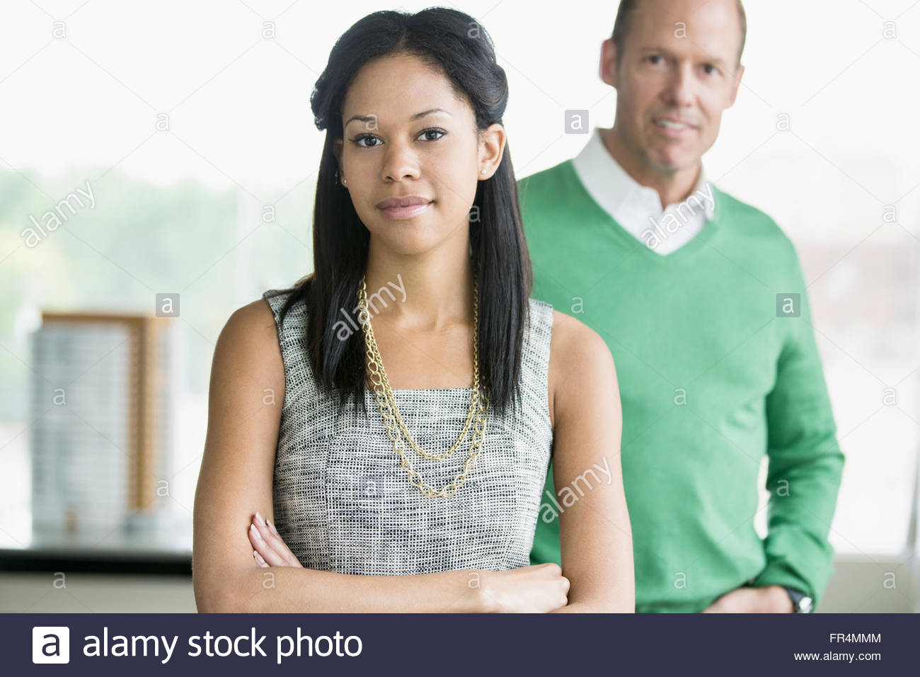 portrait of stylish coworkers in office - Stock Image