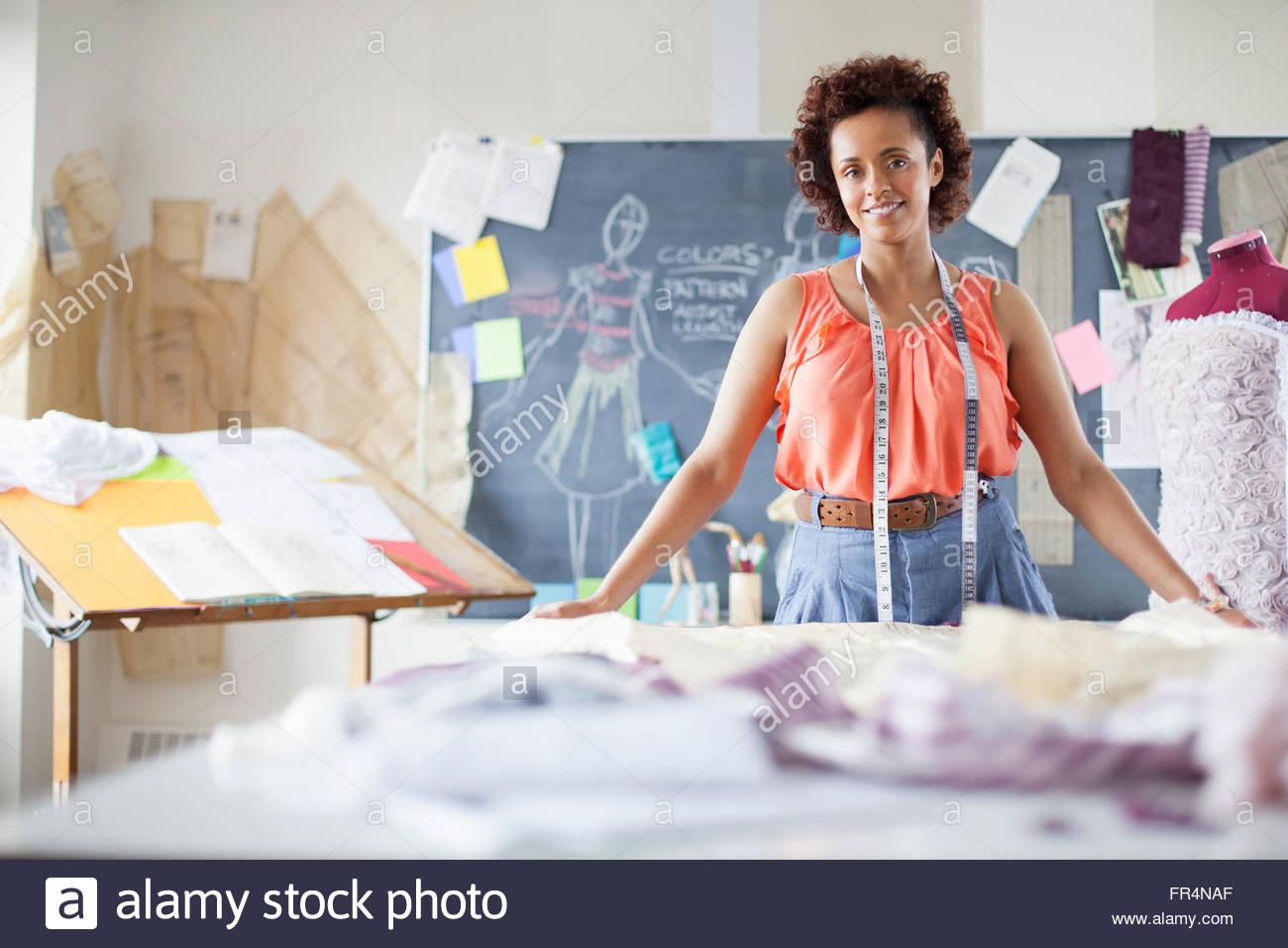 portrait of pretty, fashion designer in studio - Stock Image