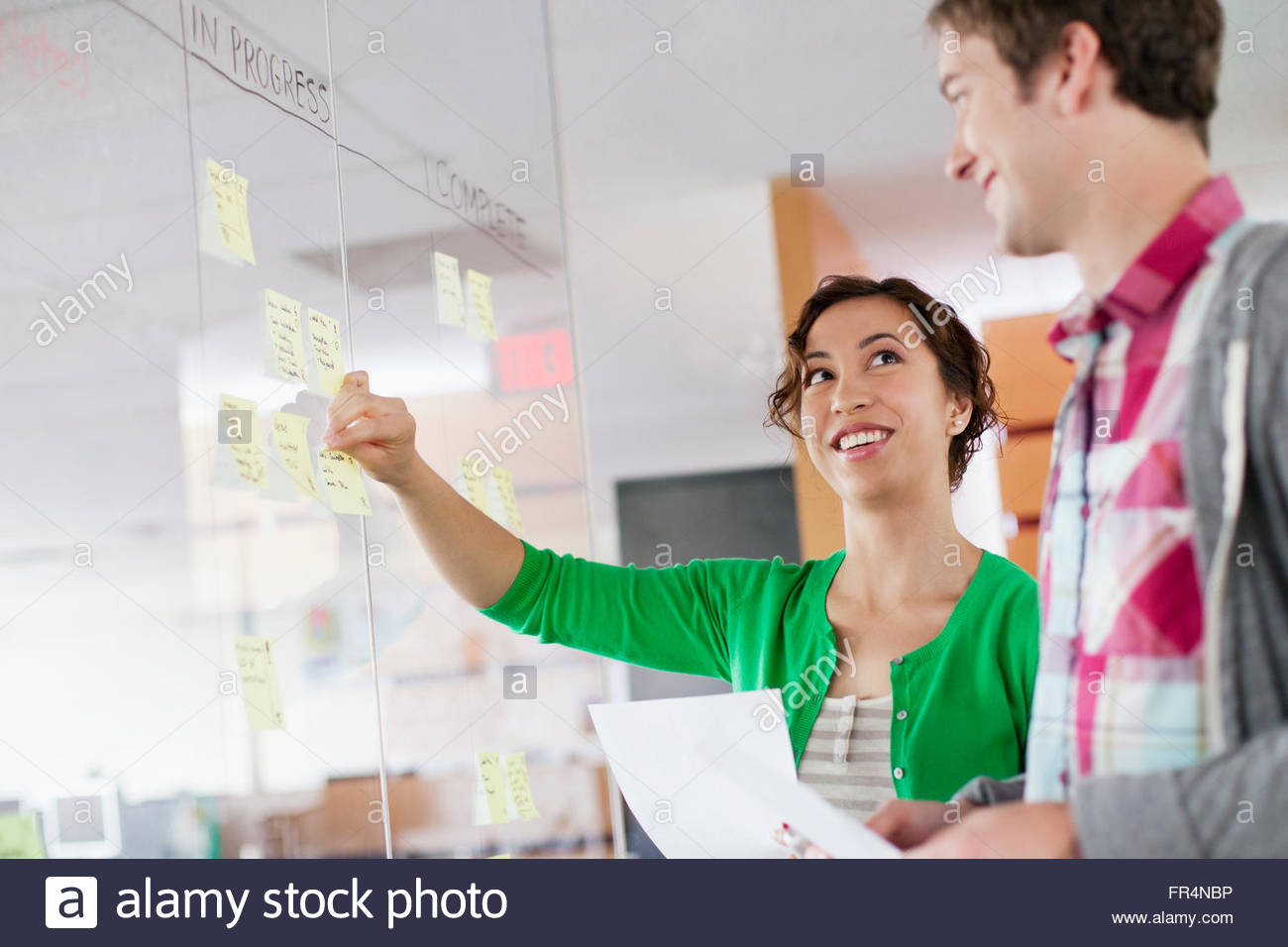 coworkers planning their workflow strategy - Stock Image
