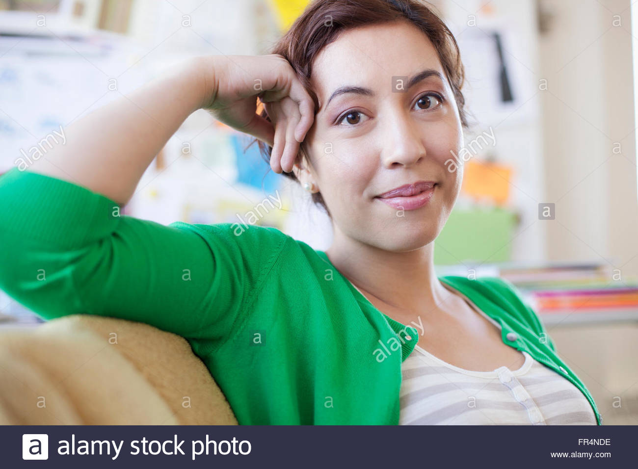 pretty, creative professional relaxing at office - Stock Image