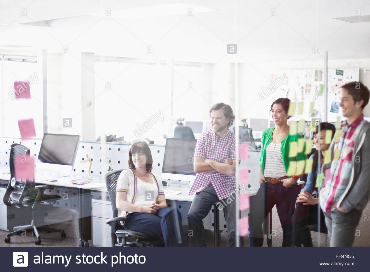 view through glass of creative team in the office - Stock Image