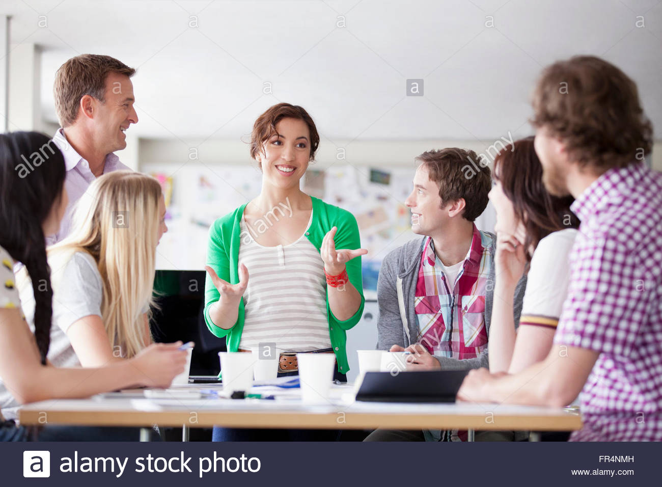 young creatives having a brainstorming session - Stock Image