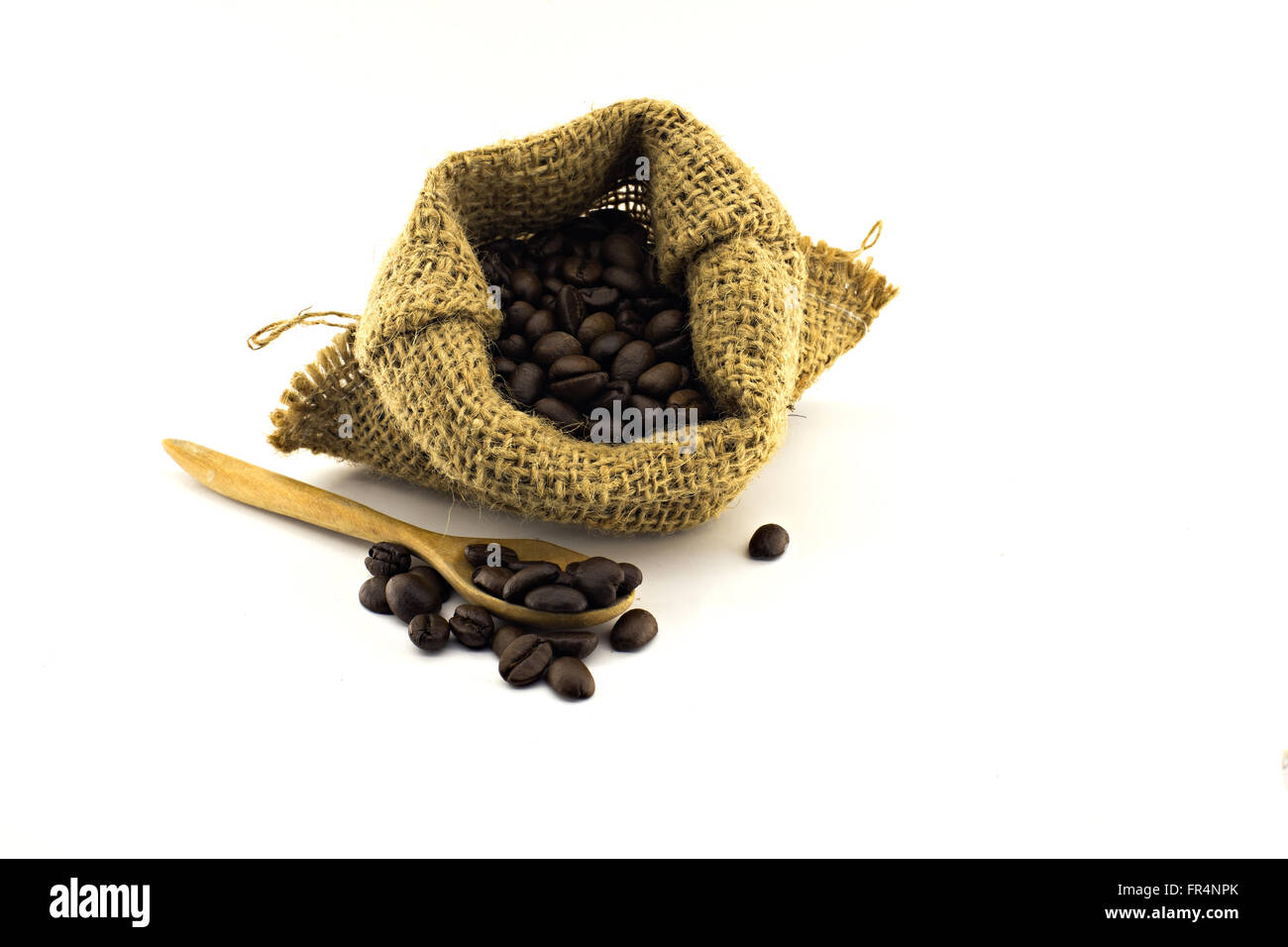 coffee beans in bag isolated on white background - Stock Image