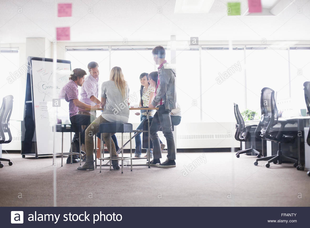 coworkers meeting in trendy business office - Stock Image