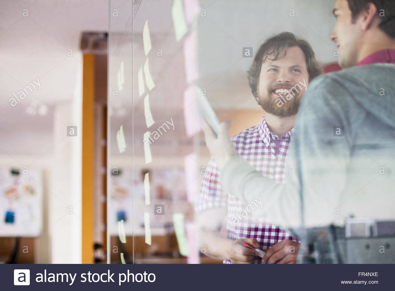coworkers reviewing their flowchart strategy - Stock Image