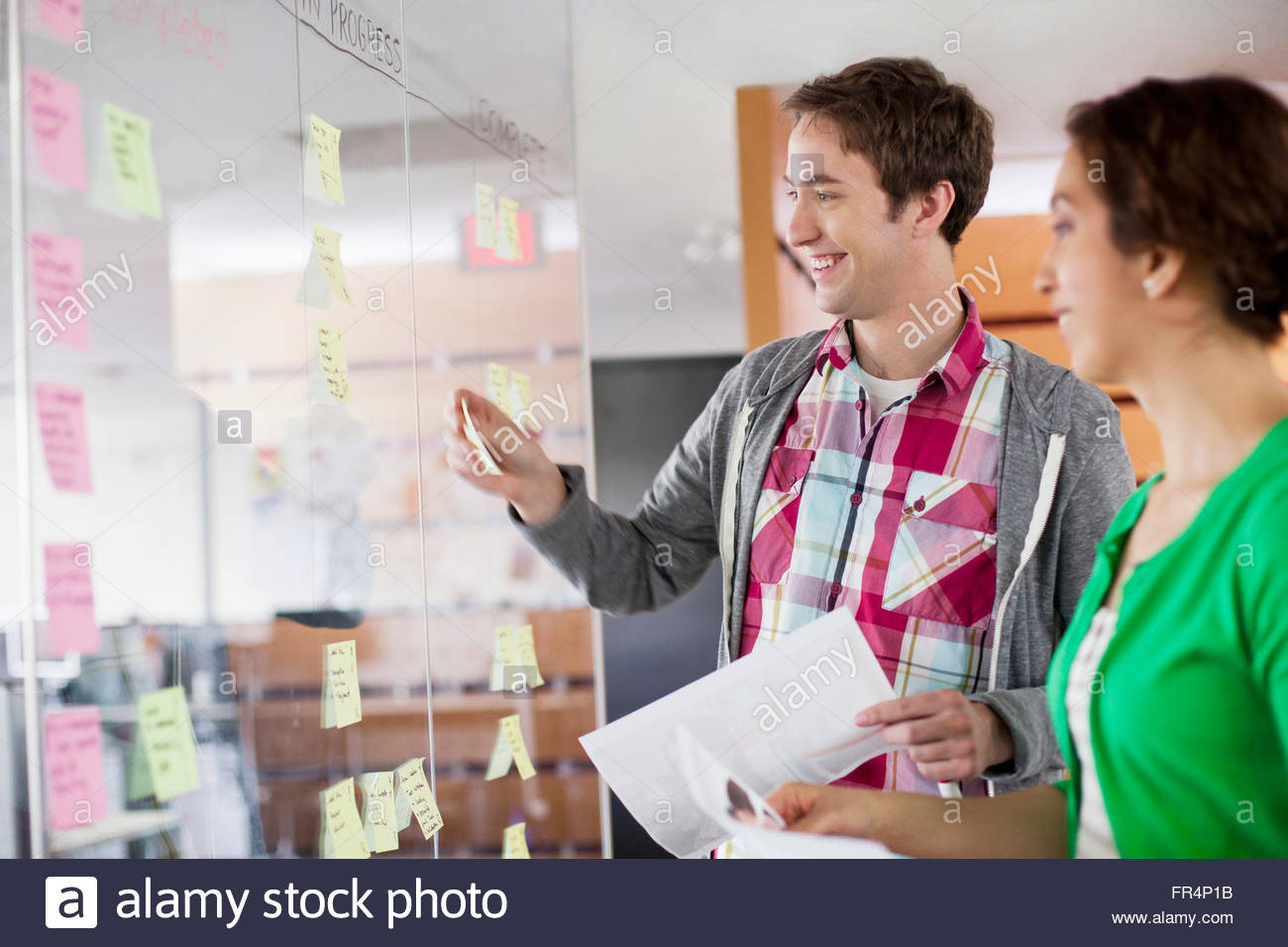 coworkers planning their work flow strategy in a modern office - Stock Image