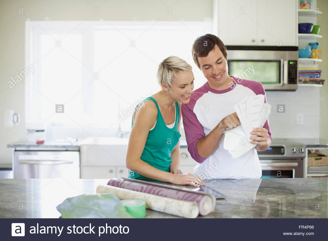 mid adult couple making renovation choices - Stock Image