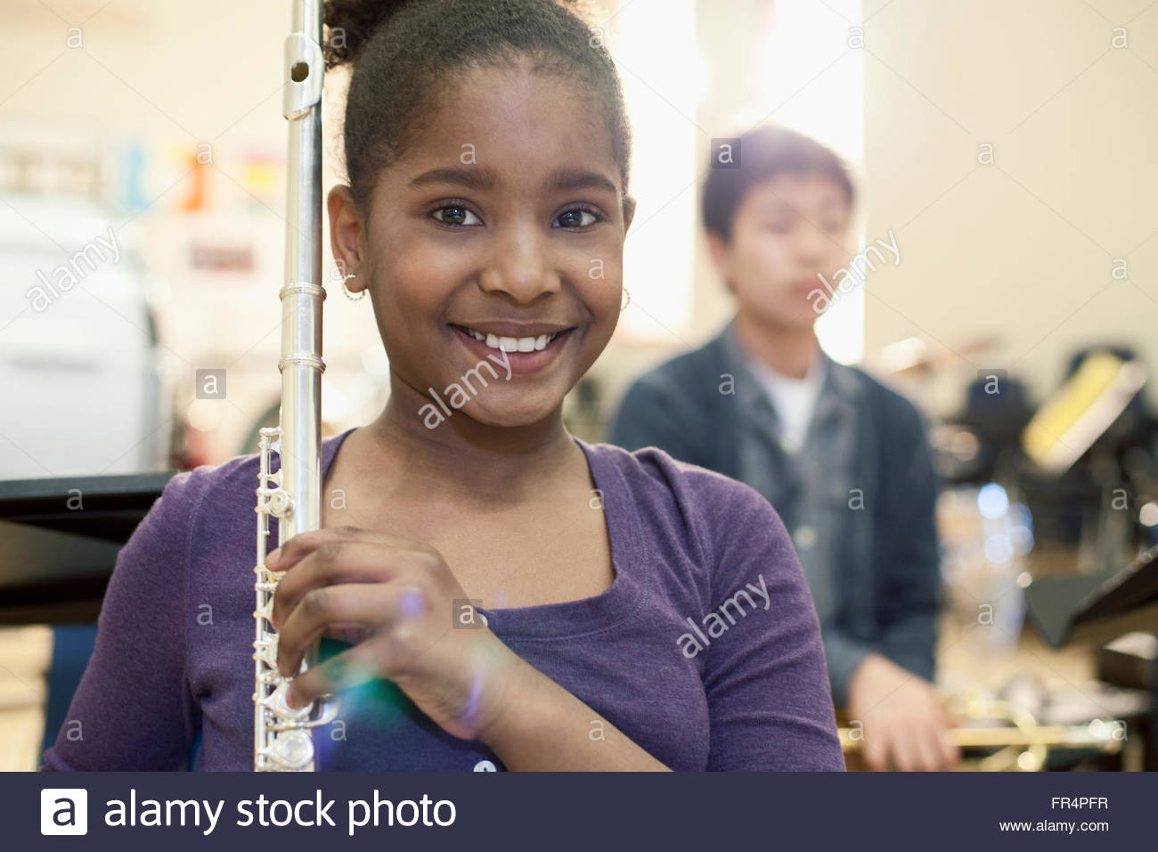 middle school student holding flute in school band - Stock Image