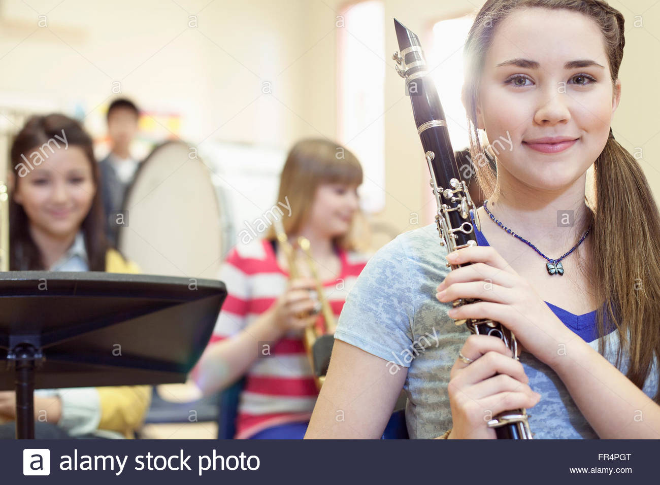 portrait of pretty school band member holding clarinet - Stock Image