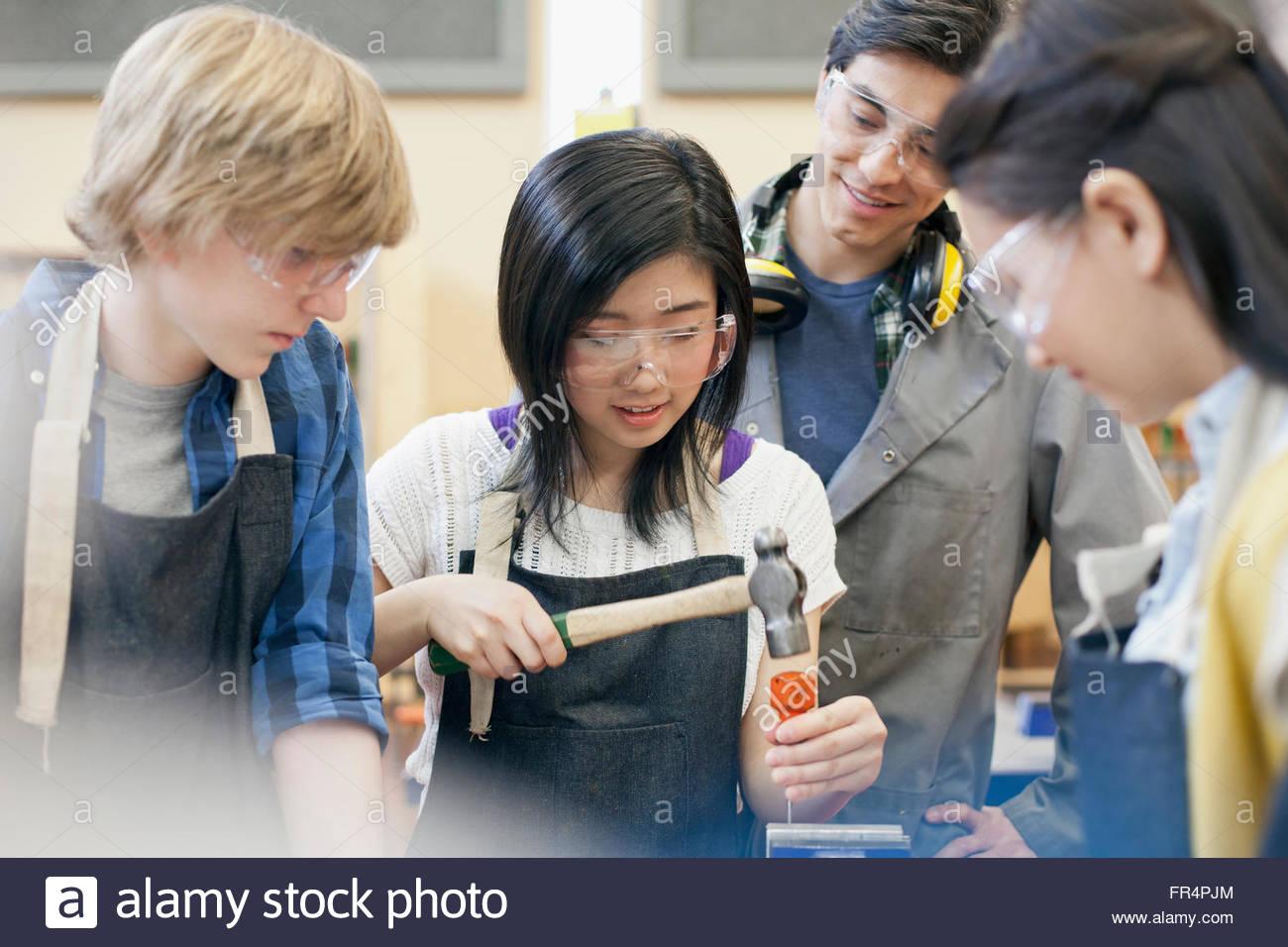 teacher supervising machine shop class - Stock Image