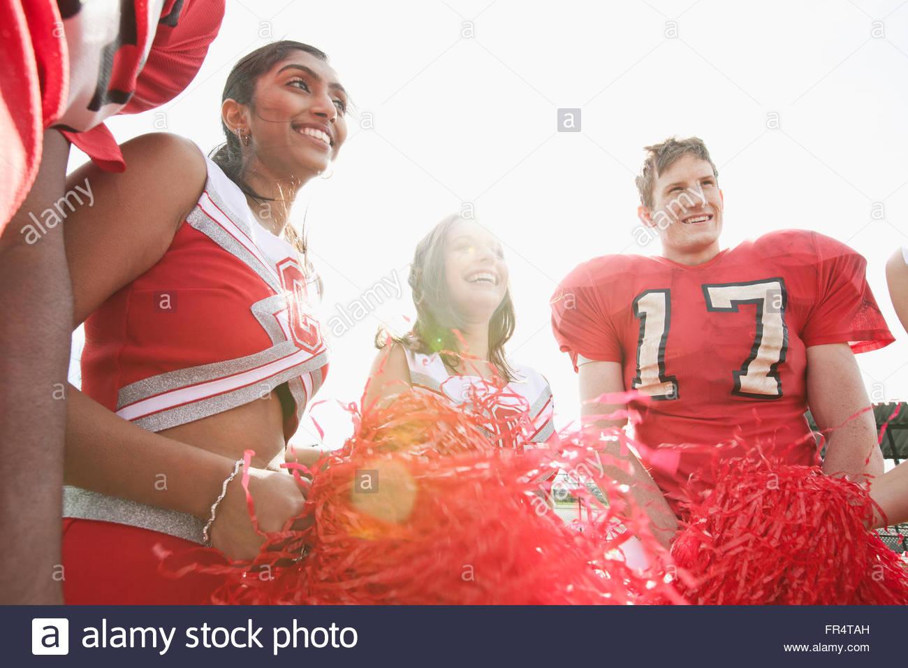 cheerleaders with football players - Stock Image