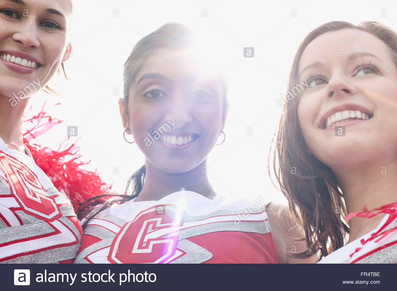 cheerleaders practicing together - Stock Image