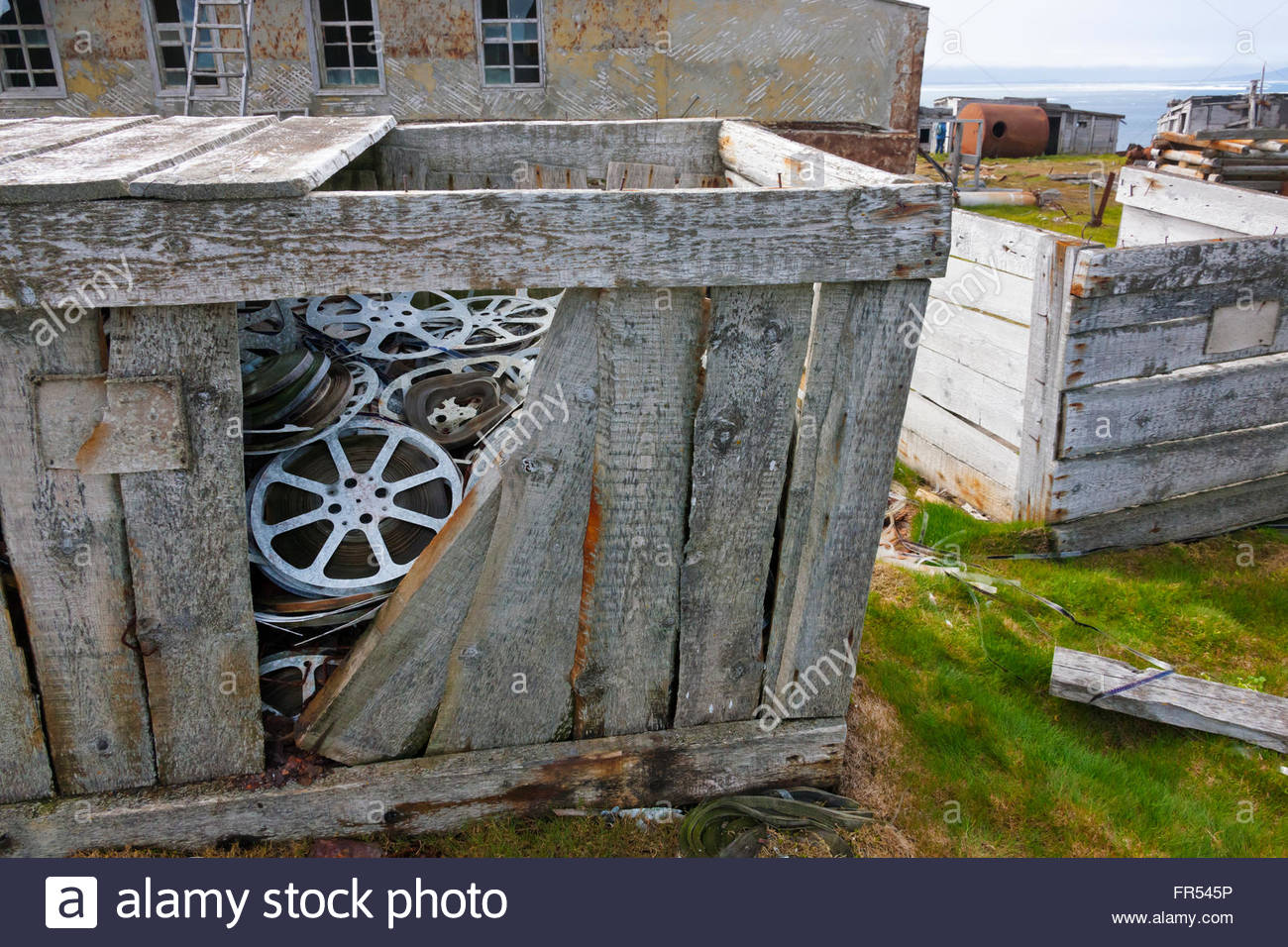 Abandoned movie films, Kolyuchin Island, once an important Russian Polar Research Station, Bering Sea, Russian Far - Stock Image