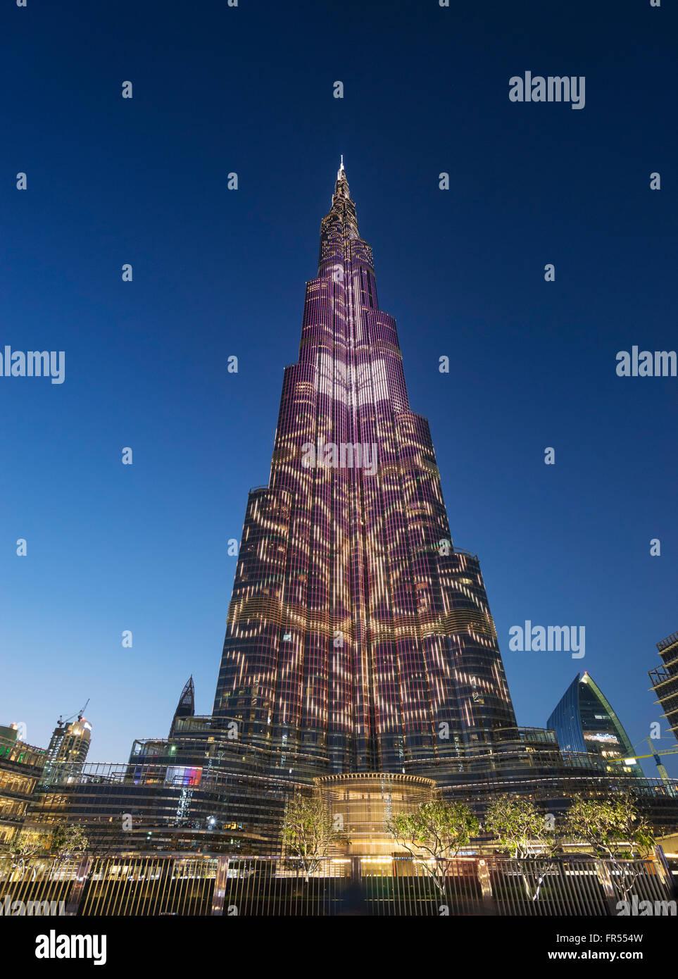Dusk view of Burj Khalifa tower with LED patterns on facade in Dubai United Arab Emirates - Stock Image
