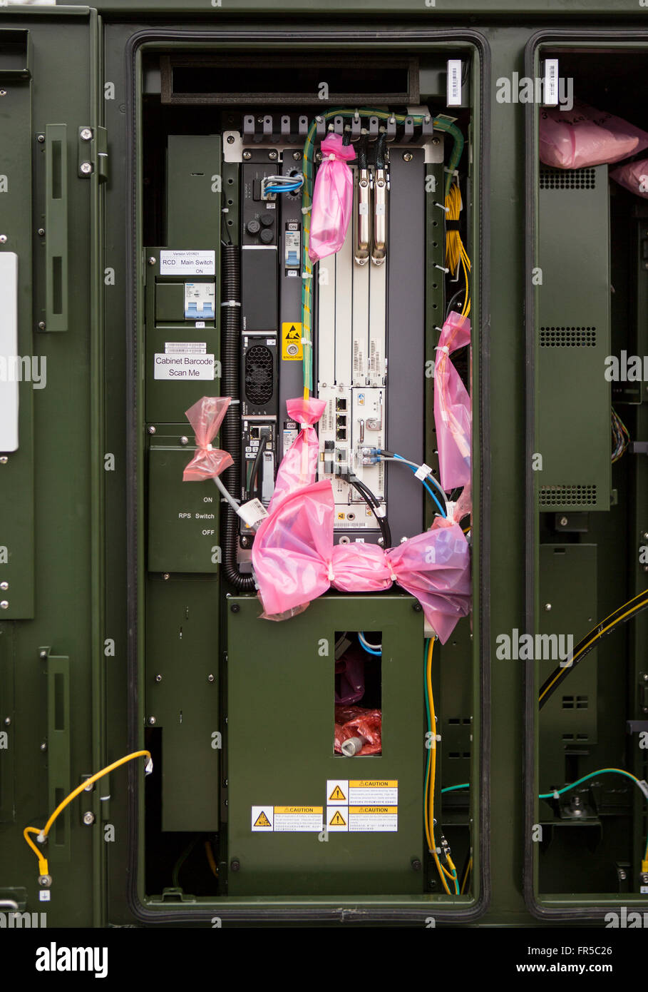BT fiber optic and telephone cabinet revealing cable connections providing rural broadband - Stock Image