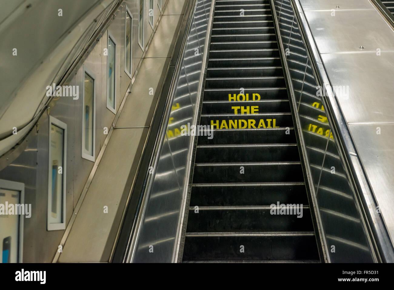 London, United Kingdom - March 20, 2016: Hold the Handrail notice on an escalator in London Underground, Euston - Stock Image