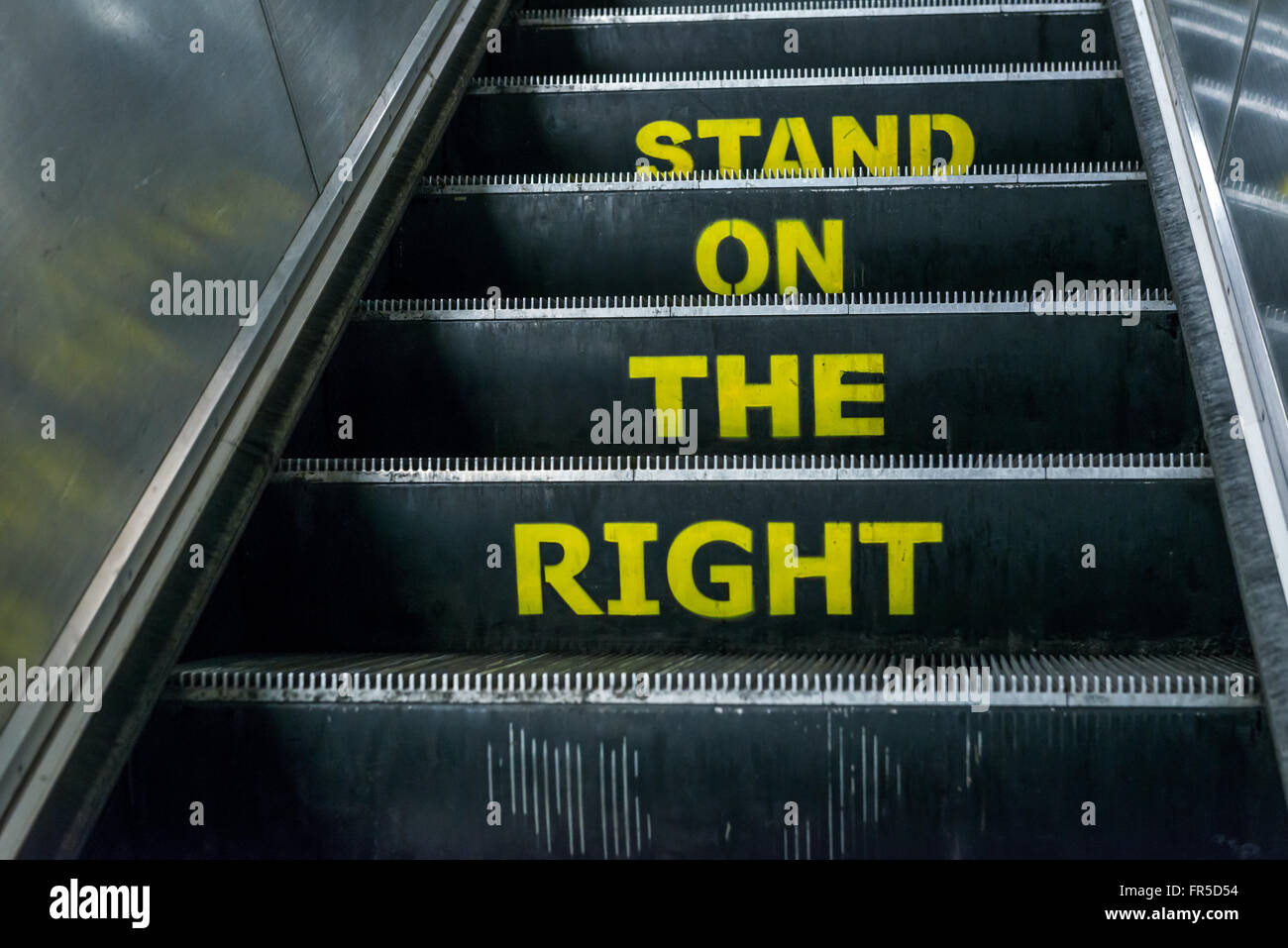 London, United Kingdom - March 20, 2016: Stand on the right notice on an escalator in London Underground, Euston - Stock Image
