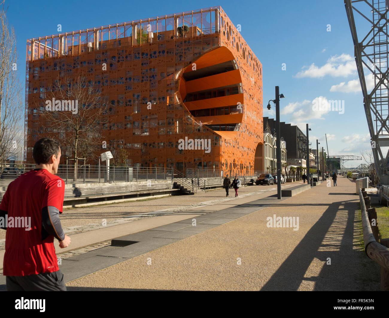 The orange cube (Jakob + Macfarlane Architects). District of the Confluence, Lyon, France. - Stock Image