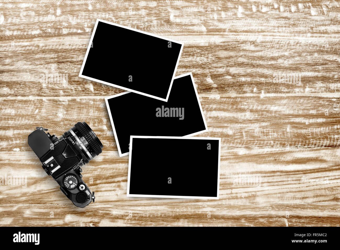 Vintage SLR film camera on grunge wooden table - Stock Image