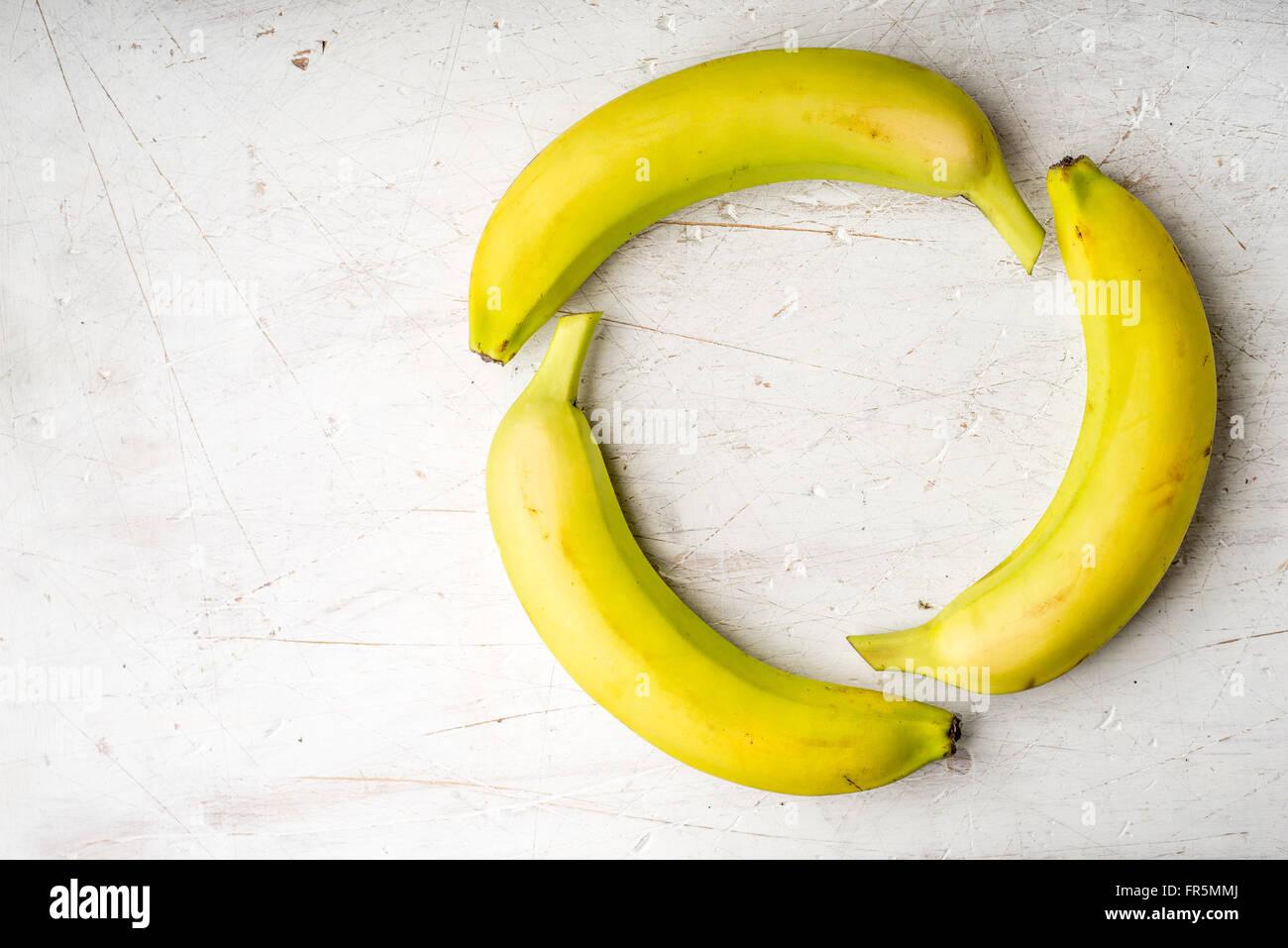 Yellow bananas on a white table horizontal - Stock Image