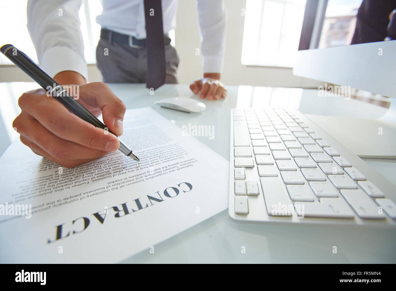 Close-up of businessman signing a contract - Stock Image