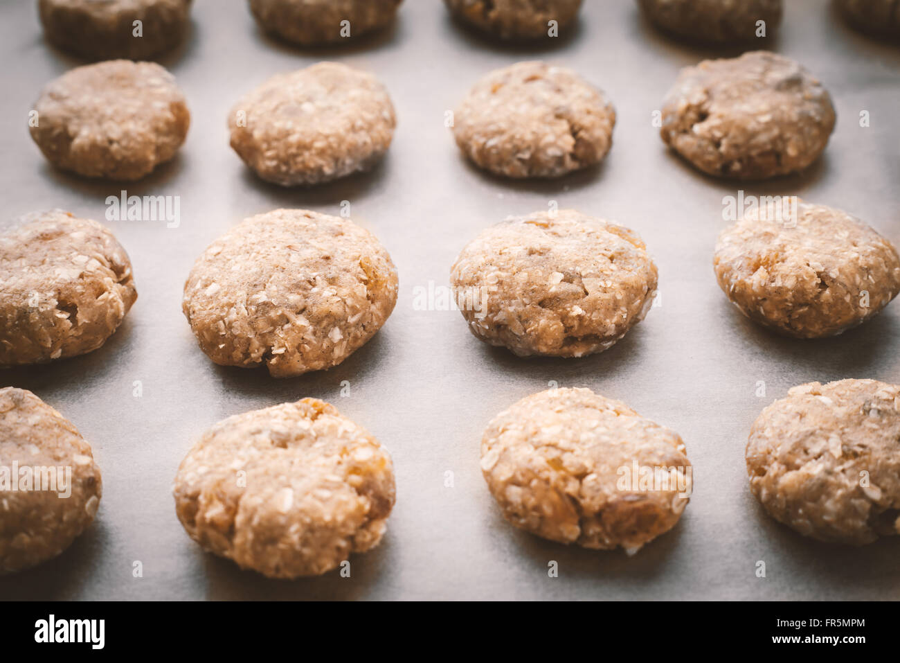 Oatmeal cookies on a baking sheet covered with parchment horizontal - Stock Image