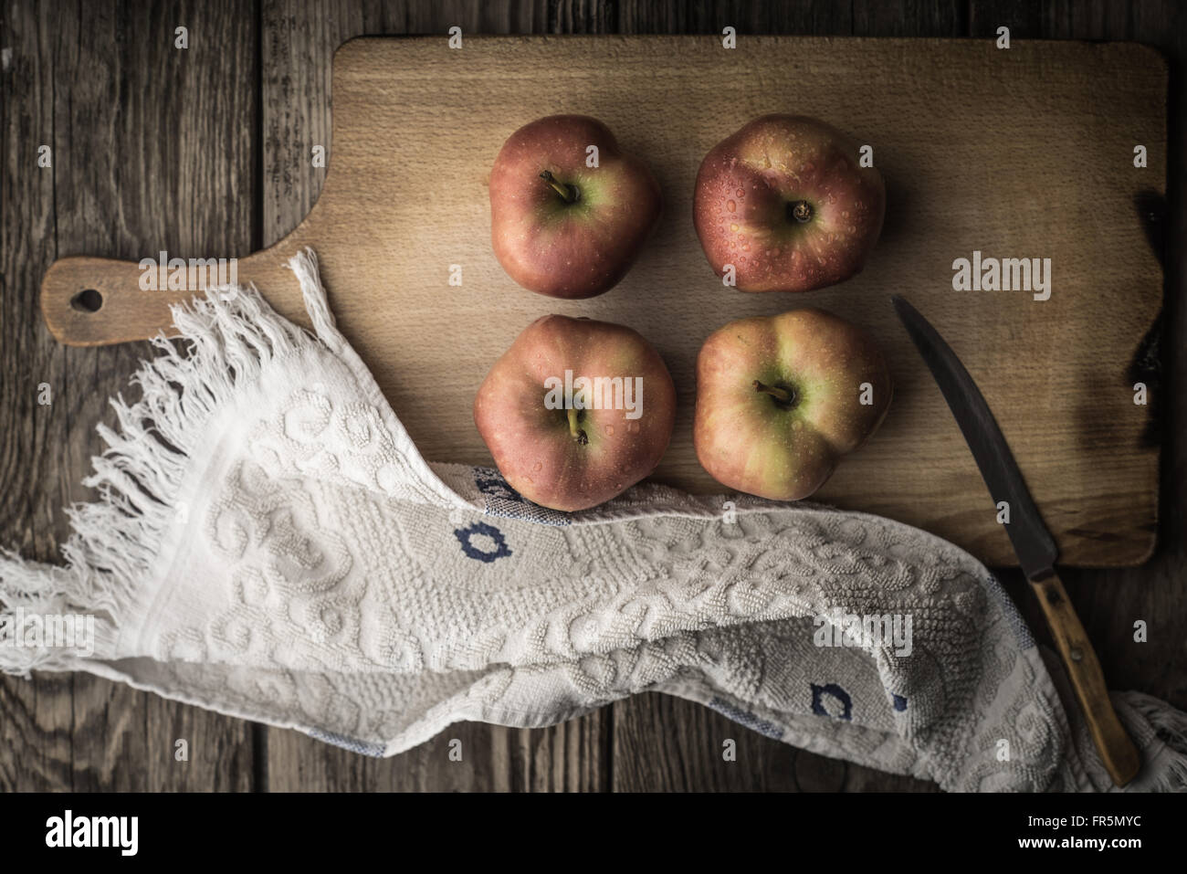 Red apples and towel on the cutting board horizontal - Stock Image