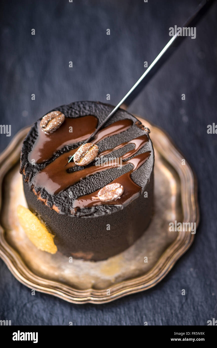 Piece of chocolate mousse cut knife vertical - Stock Image