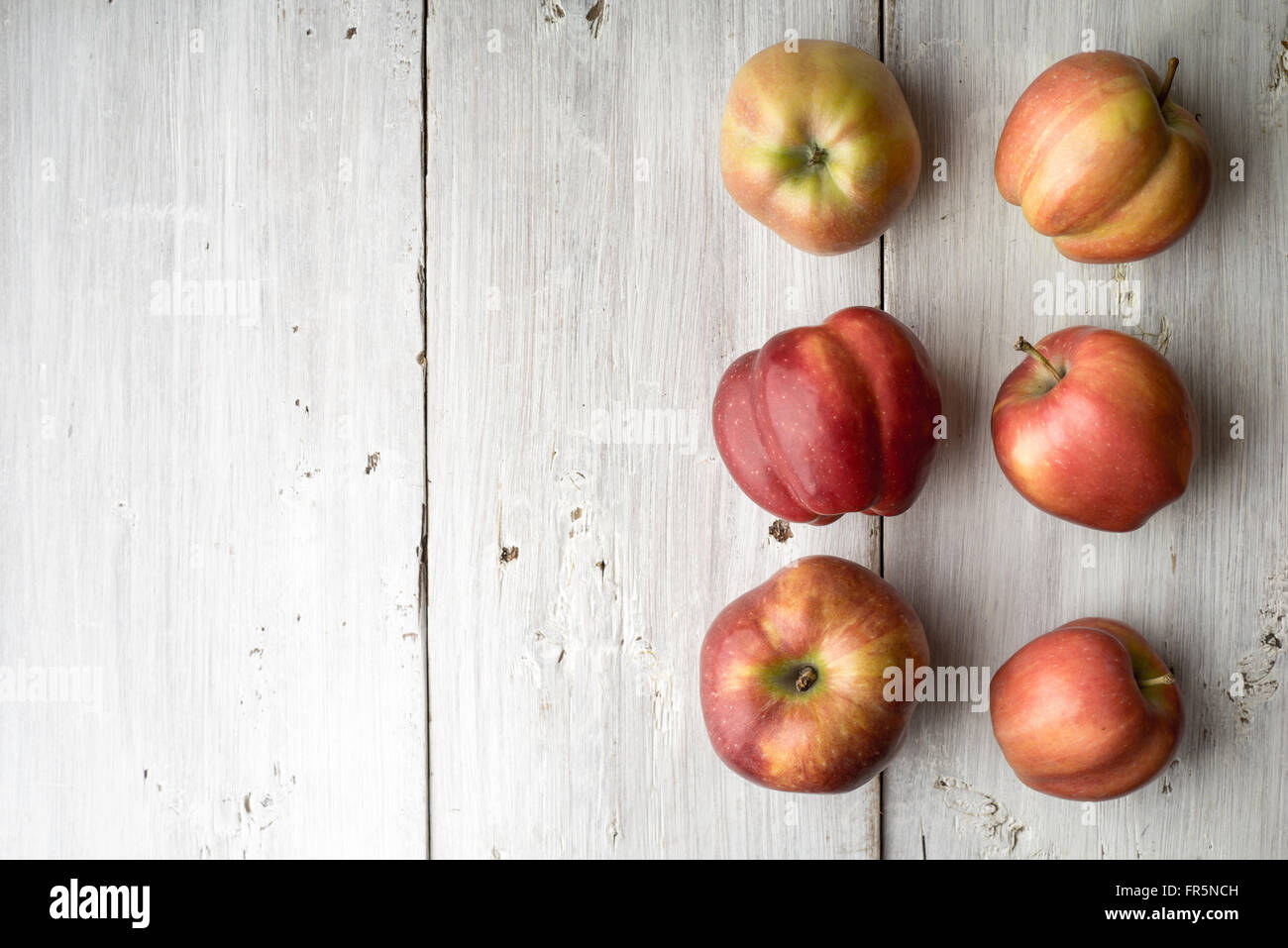 Summer red apples on white boards horizontal - Stock Image