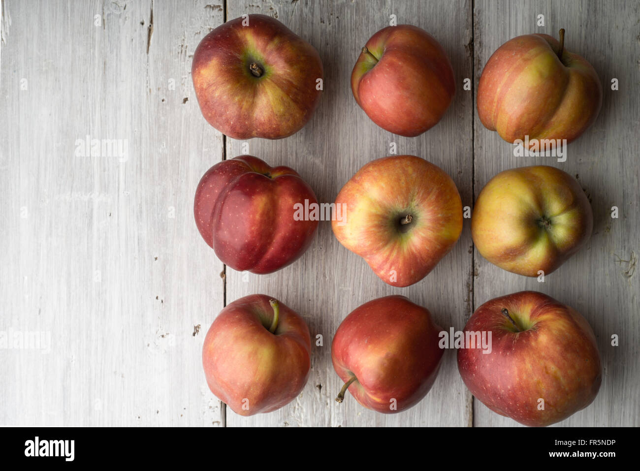 Summer red apples on white boards on the right horizontal - Stock Image