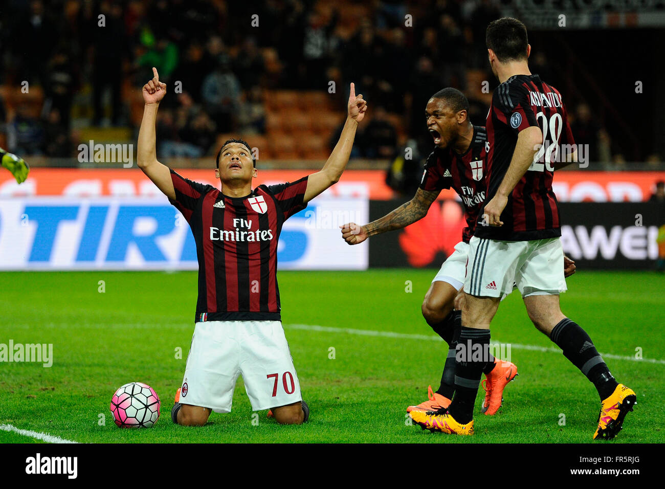 Carlos Bacca of Milan celebrates scoring draw 1-1 with Luiz Adriano and Andrea Bonaventura  Milano 20-03-2016 Stadio - Stock Image