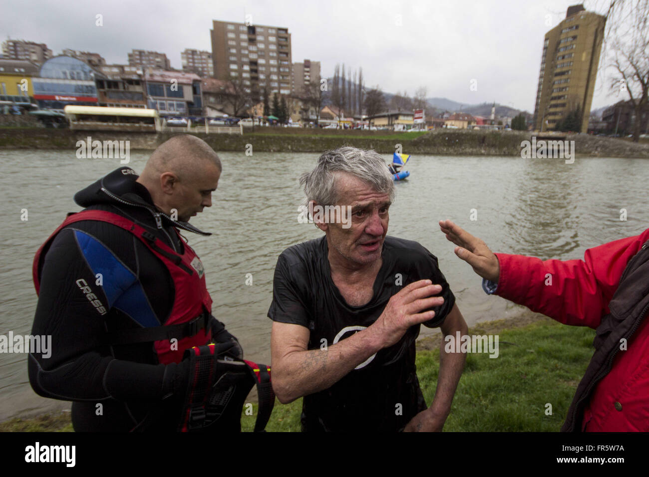 Zenica, Bosnia and Herzegovina. 21st Mar, 2016. People greet EMILIAN KNEZEVIC who is 72 years old. He swims every - Stock Image